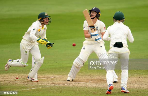Nat Sciver of England reacts as she is bowled as Alyssa Healy of Australia celebrates during Day Four of the Kia Women's Test Match between England...