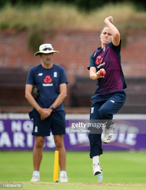 Nat Sciver of England Women bowls as Mark Robinson Head Coach of England Women looks on during England Women Nets Session at The Cooper Associates...