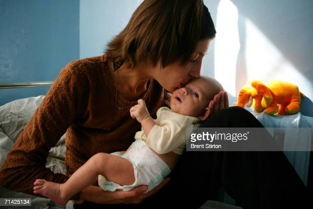 Natacha 28 is seen in hospital with her youngest a baby girl of 2 months on August 22 2005 in Kiev Ukraine Natacha's husband died an Aids related...