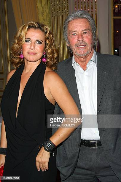 Natacha Amal and Alain Delon at the Cercle Interallie in Paris France on June 03 2009