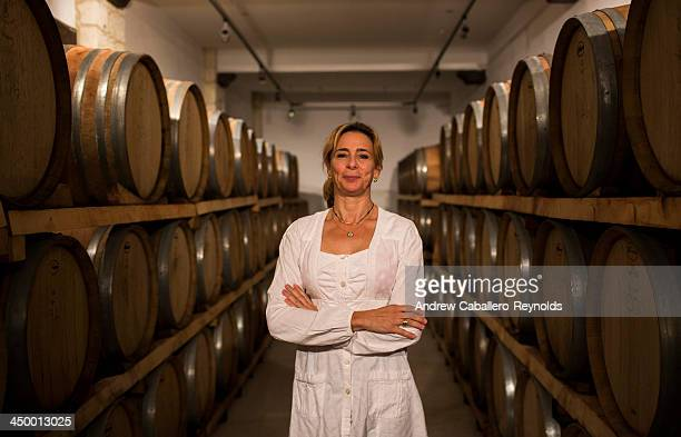 Natacha Hadjiantona owner and manager of the Hadjiantonas Winery poses for a photo in the main celler on November 16 2013 in Parekklisia Cyprus With...
