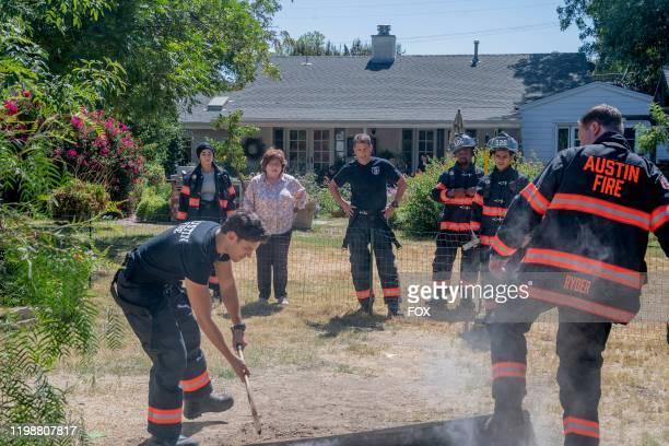 Natacha Karam Ronen Rubenstein guest star Patrika Darbo Rob Lowe Brian Michael Smith Julian Works and Jim Parrack in the YeeHaw episode of 911 LONE...