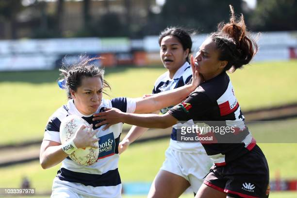 Natahlia Moors of Auckland fends Waikohika Flesher of Counties Manukau during the round three Farah Palmer match between Counties Manukau and...