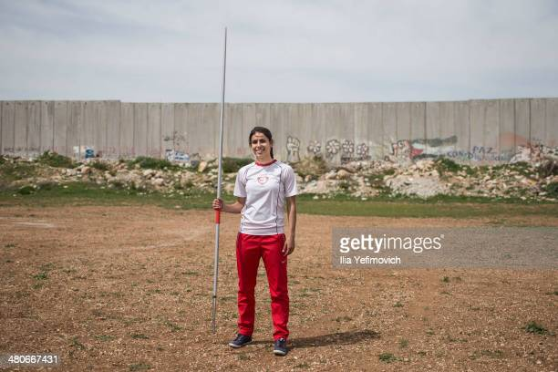 Natali Shaheen a student at Al Quds University sports department posing for a portrait with her javelin during a practise at Al Quds University on...