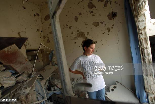 Natalia Abu Karim stands in the remains of her childhood bedroom in the Christian village of Al Qawzah, in Southern Lebanon, August 21, 2006....
