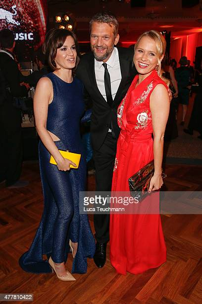 Natalia Avelon Kai Wiesinger and Nova Meierhenrich attends the German Film Award 2015 Lola party at Palais am Funkturm on June 19 2015 in Berlin...