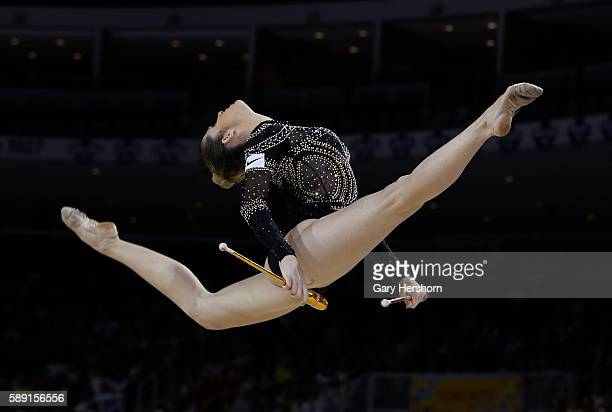 Natalia Azevedo Gaudio of Brazil performs her routine in the clubs competition in rhythmic gymnastics at the Toronto 2015 PanAm Games in Toronto July...