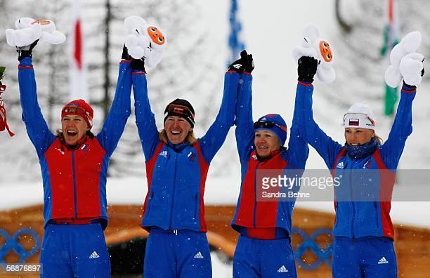 Natalia BaranovaMasolkina Larisa Kurkina Evgenia MedvedevaAbruzova Julija Tchepalova of Russia celebrate winning the Gold Medal in the Womens Cross...