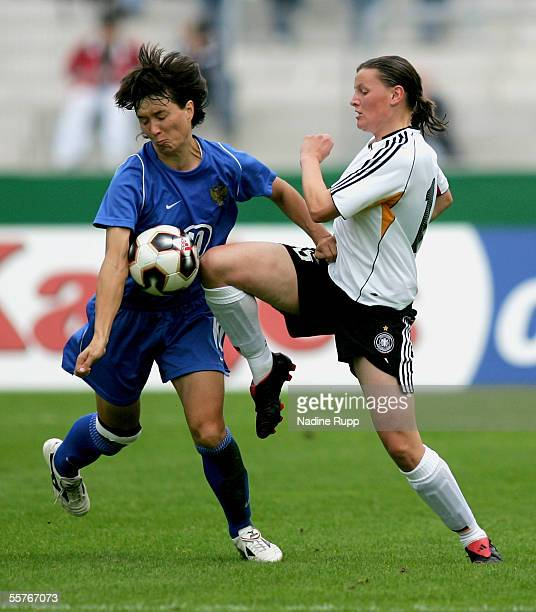 Natalia Barbashina of Russia competes with Pia Wunderlichof Germany during the women's World Cup qualifying match between Germany and Russia at...