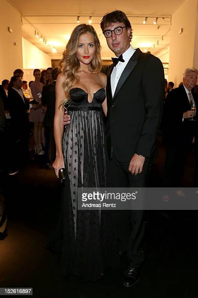 Natalia Borges and Lorenzo Tonetti attend the amfAR Milano 2012 Cocktail reception during Milan Fashion Week at La Permanente on September 22 2012 in...