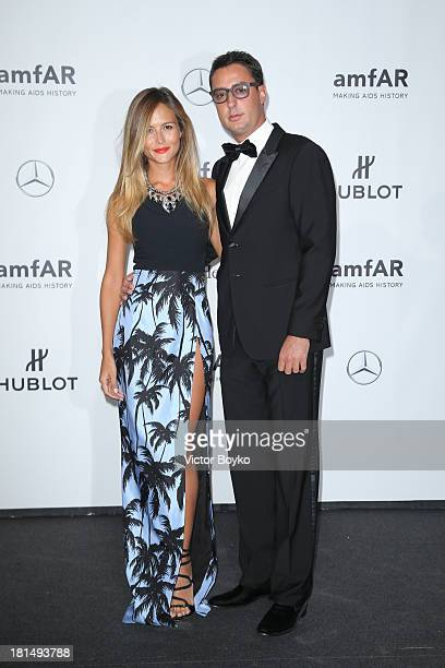 Natalia Borges and Lorenzo Tonetti attend the amfAR Milano 2013 Gala as part of Milan Fashion Week Womenswear Spring/Summer 2014 at La Permanente on...