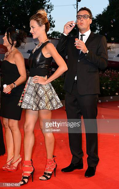 Natalia Borges and Lorenzo Tonetti guests of JaegerLeCoultre wearing their watch creates soap bubbles on the red carpet for the 'Emergency' charity...