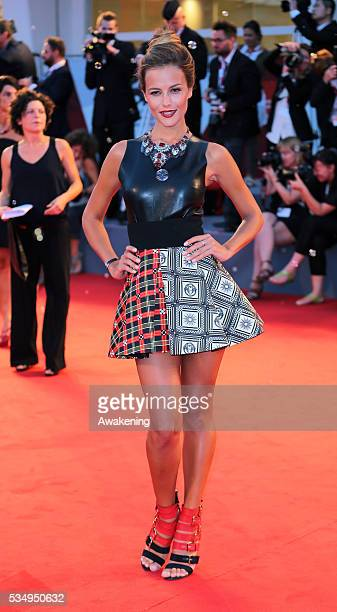 Natalia Borges creates soap bubbles on the red carpet for the 'Emergency' charity at the 'Tracks' premiere during the 70th Venice Film Festival