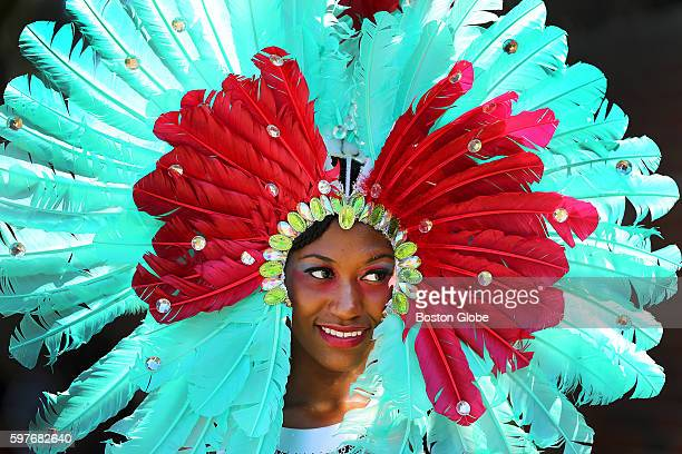 Natalia Brown with the Royalty group wears aqua feathers in her headdress during the annual Caribbean Carnival Parade in Dorchester on Aug 27 2016...