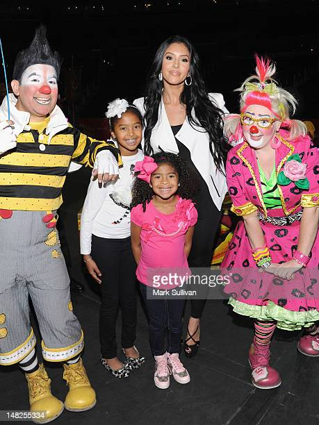 Natalia Bryant Vanessa Bryant and Gianna Bryant pose with clowns at the Los Angeles premiere of Ringling Bros and Barnum Bailey DRAGONS at Staples...