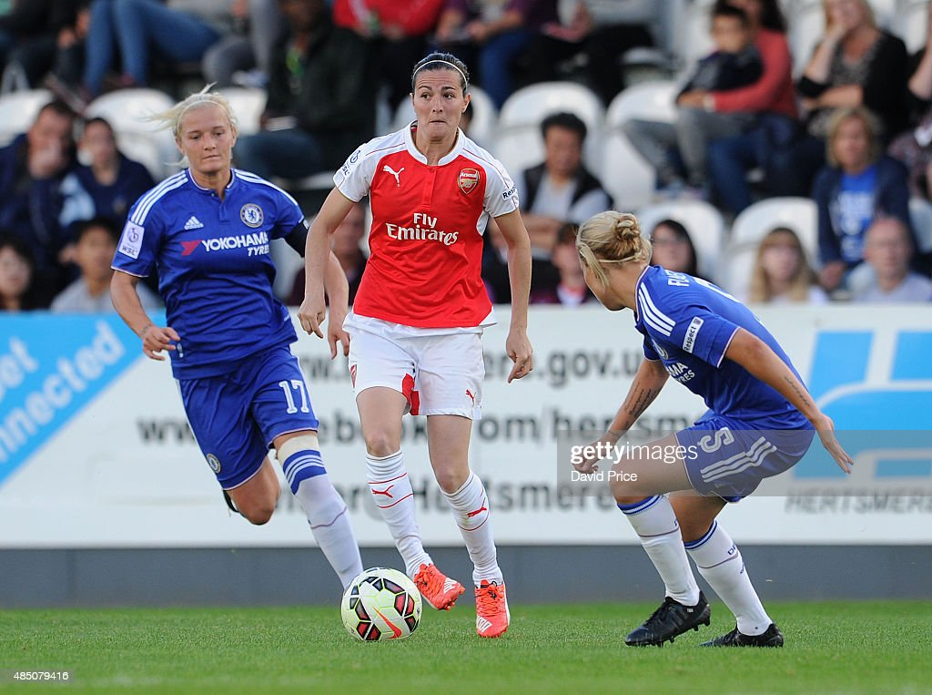Natalia De Pablos Sanchon of Arsenal takes on Katie Chapman and Gilly Flaherty of Chelsea during the match between Arsenal Ladies and Chelsea Ladies at Meadow Park on August 23, 2015 in Borehamwood, England.