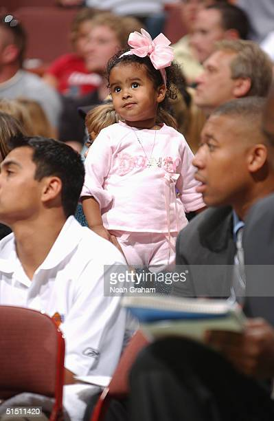 Natalia Diamante Bryant watches her farther Kobe Bryant of the Los Angeles Lakers challenge the Seattle Sonics in the preseason game on October 12...