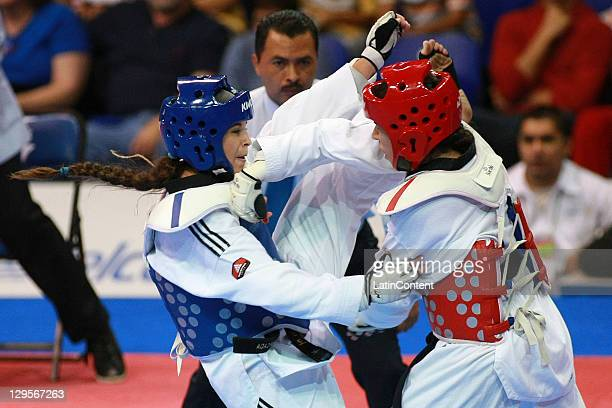 Natalia Forcada of Argentina in action with Nikki Martinez of Puerto Rico at the women's Taekwondo Heavy category to 73 kg 99 kg during the 2011 XVI...