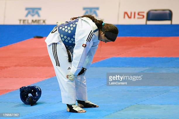 Natalia Forcada of Argentina reacts at the women's Taekwondo Heavy category to 73 kg 99 kg during the 2011 XVI Pan American Games at CODE II...