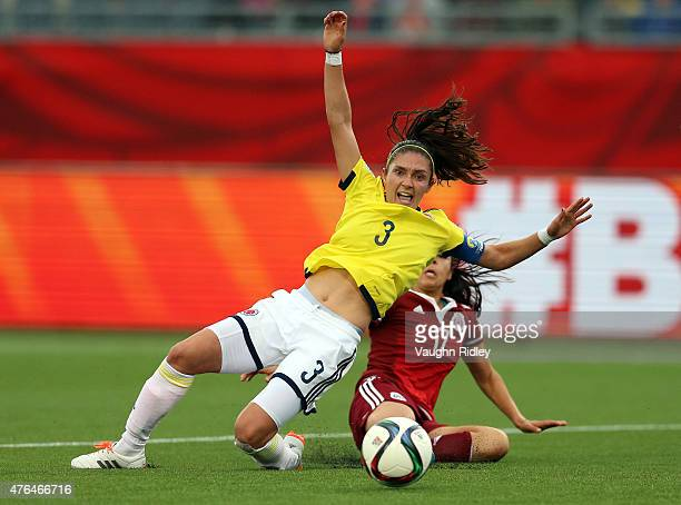 Natalia Gaitan of Colombia attempts to block a shot on goal by Carolina Arias of Mexico during the FIFA Women's World Cup Group F match between...