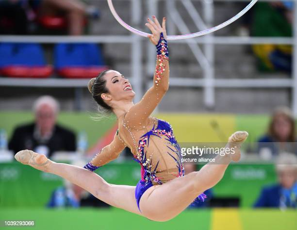 Natalia Gaudio of Brazil in action during her Hoop performance at the Individual AllAround Qualification of the Rhythmic Gymnastics events of the Rio...