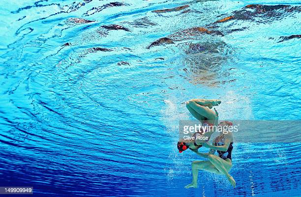Natalia Ischenko and Svetlana Romashina of Russia compete in the Women's Duets Synchronised Swimming Free Routine Preliminary on Day 10 of the London...
