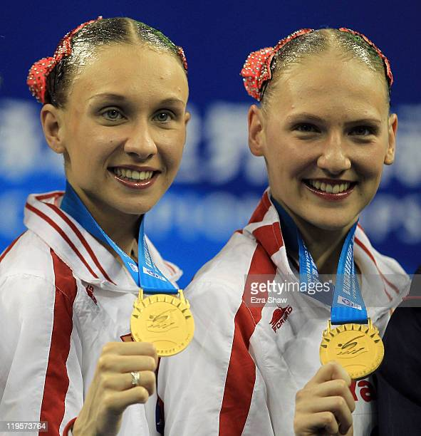 Natalia Ishchenko and Svetlana Romashina of Russia attend the victory ceremony for the Synchronized Swimming Duet Free during Day Seven of the 14th...