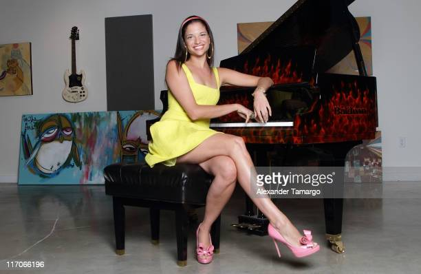 Natalia Jimenez poses during a photo session to promote her new selftitled debut album 'Natalia Jimenez' at Gibson Showroom on June 20 2011 in Miami...