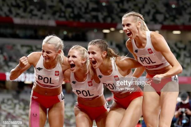 Natalia Kaczmarek, Iga Baumgart-Witan, Malgorzata Holub-Kowalik and Justyna Swiety-Ersetic of Team Poland celebrate after winning the silver medal in...