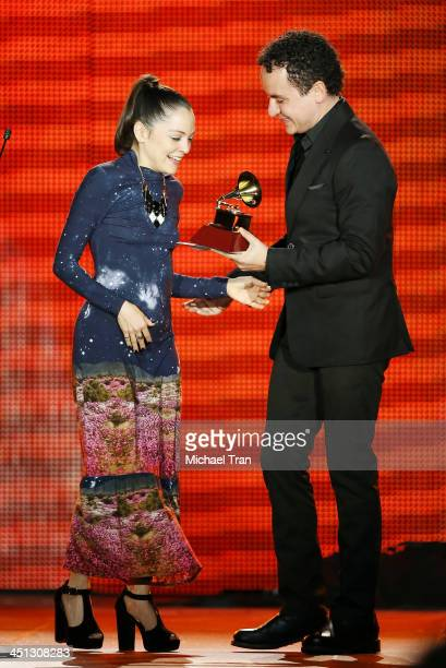 Natalia Lafourcade accepts the award for Best Alternative Music Album for 'Mujer Divina Homenaje a Agustin Laraonstage' from presenter Fonseca...