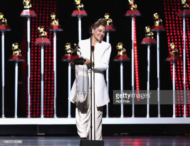 Natalia Lafourcade accepts the award for Best Folk Album onstage at the Premiere Ceremony during the 19th Annual Latin GRAMMY Awards at MGM Grand...