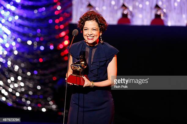 Natalia Lafourcade accepts the Record of the Year award for 'Hasta la Raiz onstage during the 16th Latin GRAMMY Awards premiere ceremony at the MGM...
