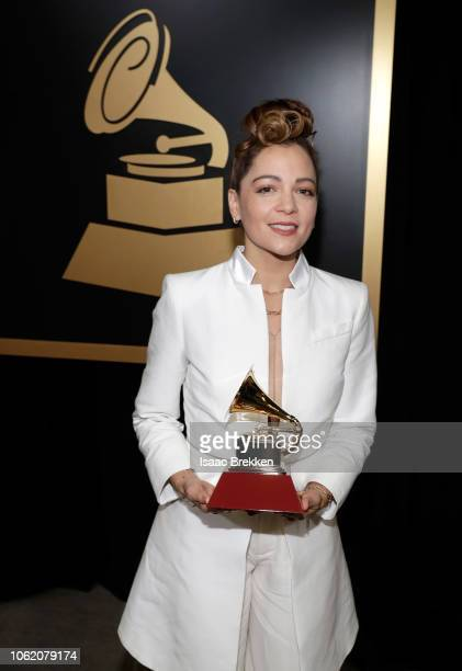 Natalia Lafourcade poses with the Best Folk Album award backstage at the Premiere Ceremony during the 19th Annual Latin GRAMMY Awards at MGM Grand...