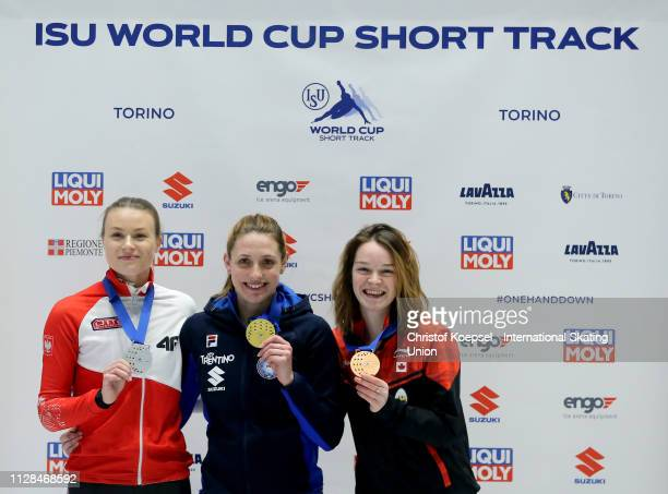 Natalia Maliszewska of Poland celebrates winning the second place Martina Valcepina of Italy celebrates winning the first place and Kim Boutin of...
