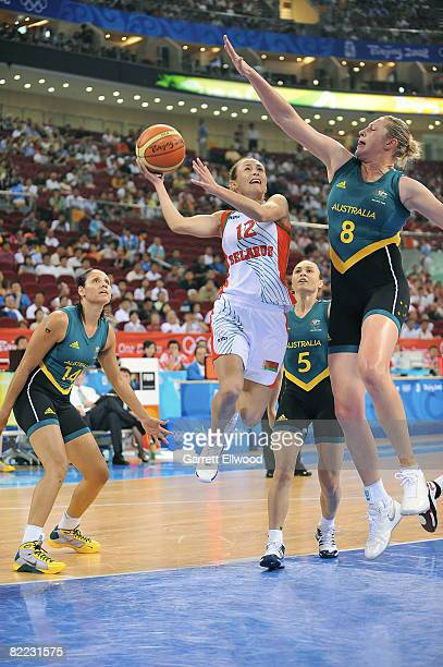 Natalia Marchanka of Belarus shoots against Suzy Batkovic of Australia during day one of basketball at the 2008 Beijing Summer Olympics on August 9...