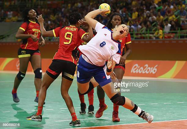 Natalia Marina Bernardo of Angola challenges Anna Sen of Russia during the Womens Quarterfinal match between Russia and Angola on Day 11 of the Rio...