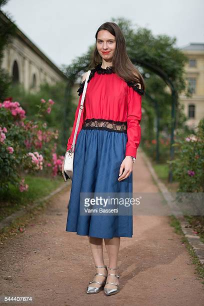 Natalia Modenova poses wearing an Anna K dress before the Ulyana Sergeenko show at Galerie de la Mineralogie during Paris Fashion Week Haute Couture...