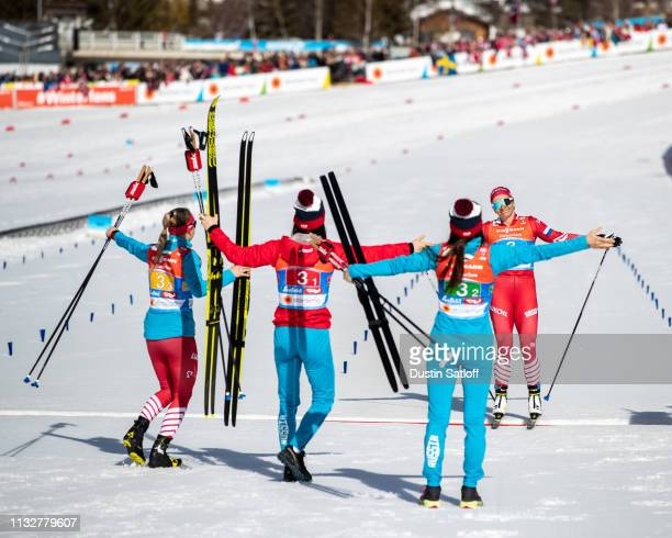 Natalia Nepryaeva of Russia crosses the finish line in third place in the Women's 4x5km Cross Country relay during the FIS Nordic World Ski...