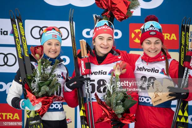 Natalia Nepryaeva of Russia Ingvild Flugstad Ostberg of Norway Anastasia Sedova of Russia at the podium after Tour de Ski Ladies 10 km Interval Start...