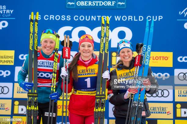 Natalia Nepryaeva of Russia takes first place Anamarija Lampic of Slovenia takes second place Jessica Diggins of USA takes third place during the...