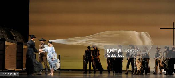 Natalia Osipova as Letty Mason and Thiago Soares as Lige Hightower with artists of the company in the Royal Ballet's production of Arthur Pita's The...