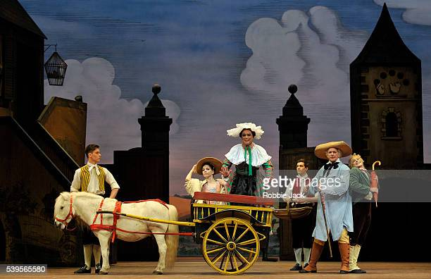 Natalia Osipova as Lise, Philip Mosley as Widow Simone, Christopher Saunders as Thomas and Paul Kay as Alain with artists of the company in the Royal...