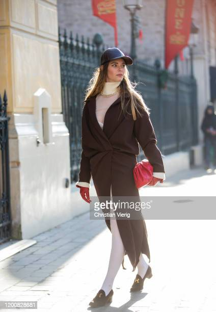 Natalia Ostrofsky seen wearing brown coat red bag outside Iris van Herpen during Paris Fashion Week Haute Couture Spring/Summer 2020 on January 20...
