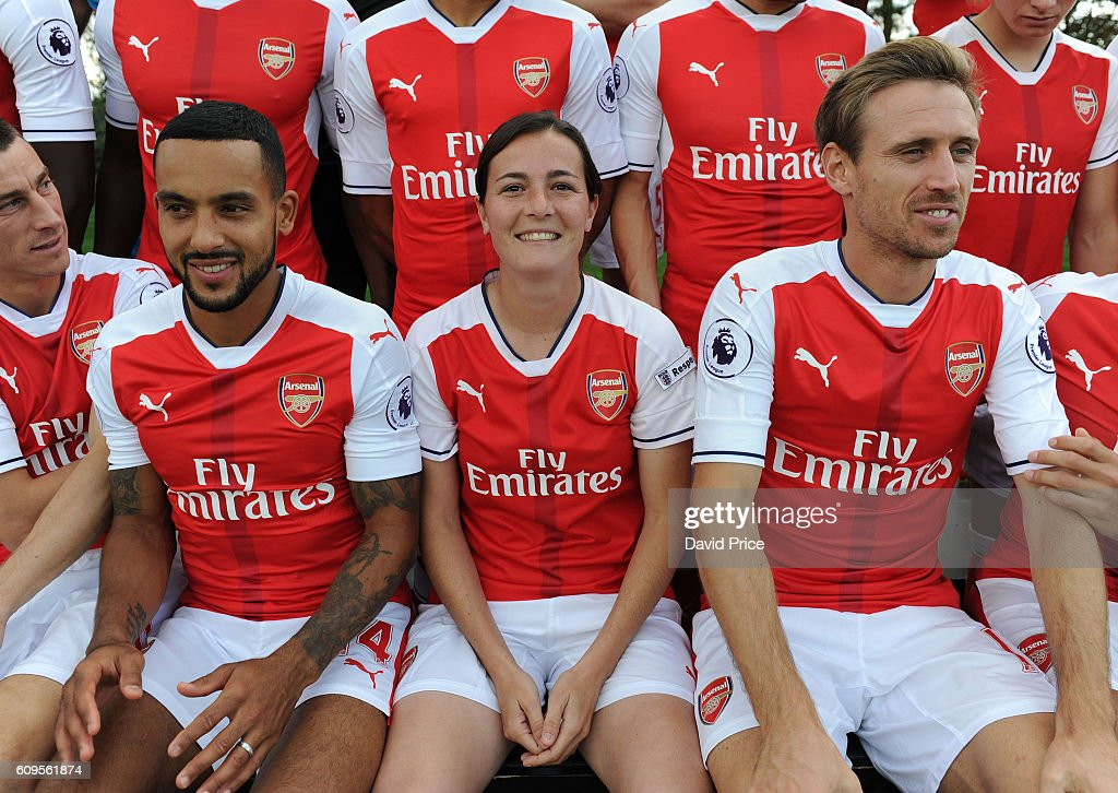 Natalia Pablos Sanchon of Arsenal Ladies sits with Theo Walcott and Nacho Monreal of Arsenal during the Arsenal Squad photos at London Colney on September 21, 2016 in St Albans, England.