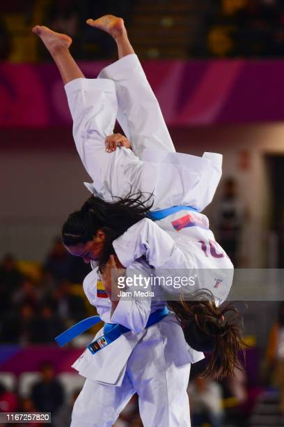 Natalia Pachon and Camila Moreno of Colombia competes during Team Women's Kata Bronze Medal Bout 1 at Villa El Salvador Sports Center on Day 14 of...