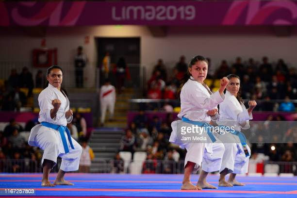 Natalia Pachon Camila Moreno and Diana Munoz of Colombia competes during Team Women's Kata Bronze Medal Bout 1 at Villa El Salvador Sports Center on...
