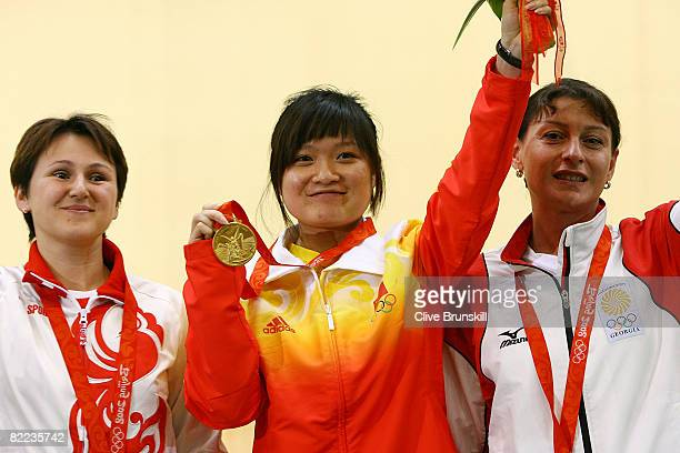 Natalia Paderina of Russia silver Guo Wenjun of China gold and Nino Salukvadze of Georgia bronze celebrate after receiving their medals in the...