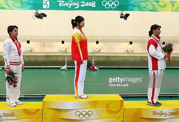 Natalia Paderina of Russia silver Guo Wenjun of China gold and Nino Salukvadze of Georgia bronze stand on the podium after receiving their medals in...