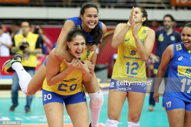 Natalia Pereira #14 Garbriella Souza #17 Suelen Pint #20 Ana Beatriz Correa and team mates of Brazil celebrate winning the semi final match between...