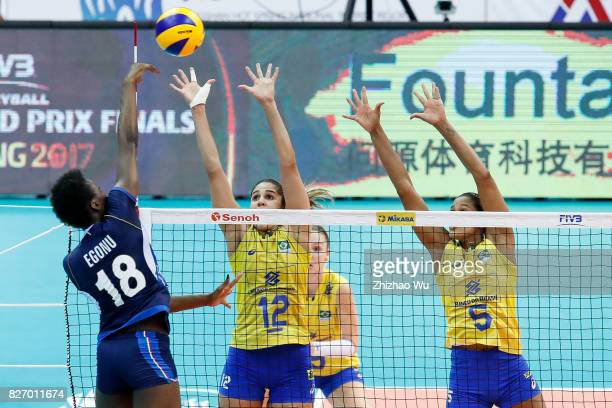 Natalia Pereira and Adenizia Da Silva of Brazil block during 2017 Nanjing FIVB World Grand Prix Finals between Italy and Brazil on August 6 2017 in...